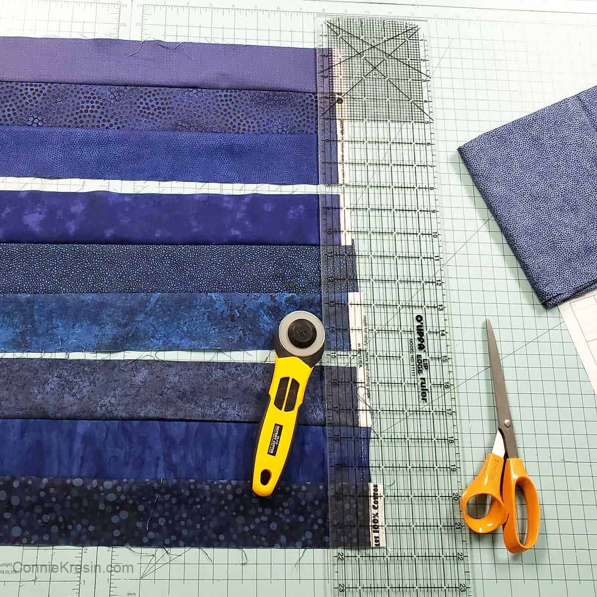 Trim the blue quilt blocks to size