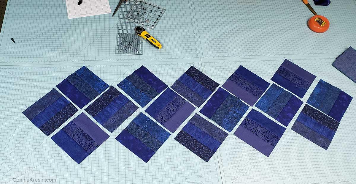 Arrange the rail fence quilt blocks