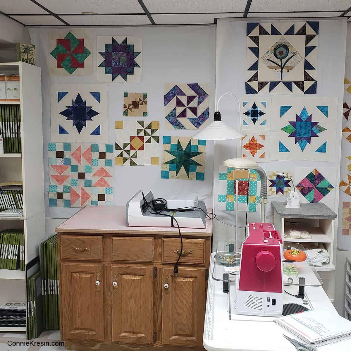 second design wall behind AccuQuilt Go cutting machine