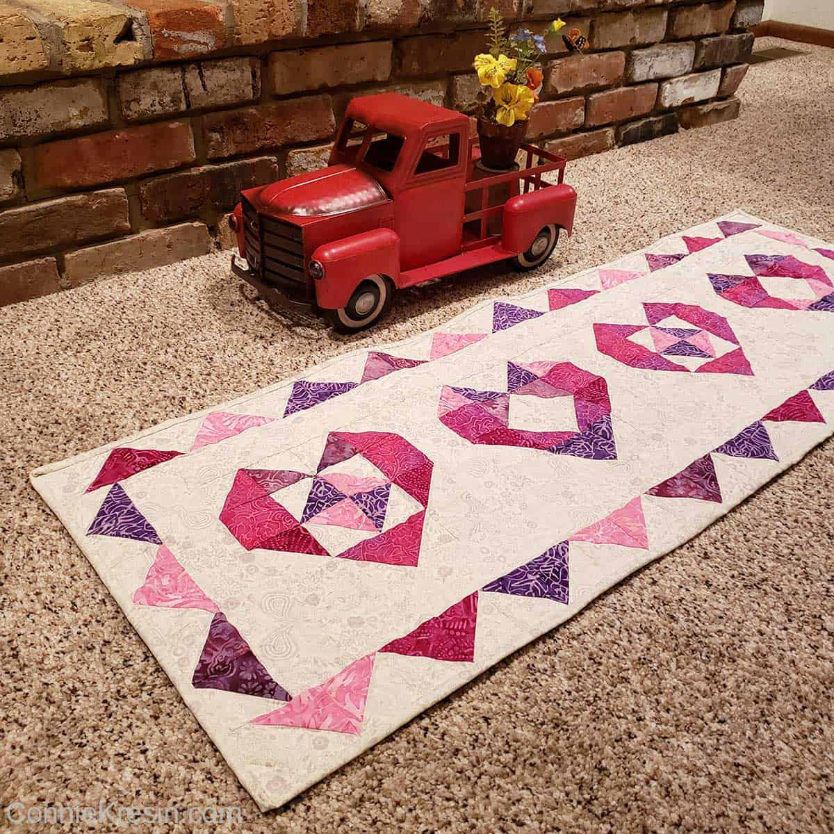 Red vintage truck by the heart table runner