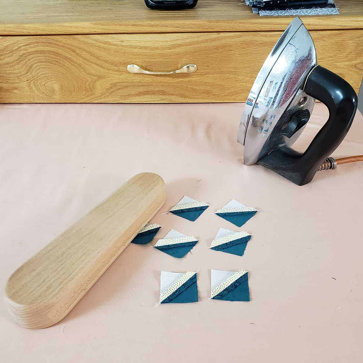 Using a tailor clapper to set the seams
