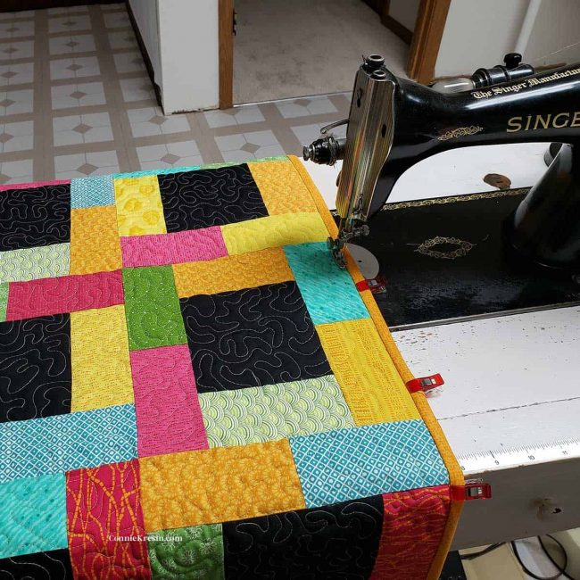 Moon Glow table runner and Singer Sewing machine