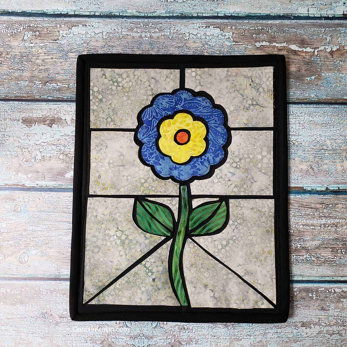 Quilted stained glass flower quilt