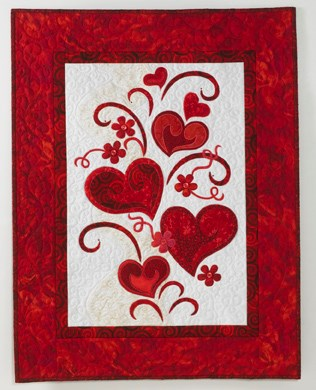 Red applique hearts wall hanging
