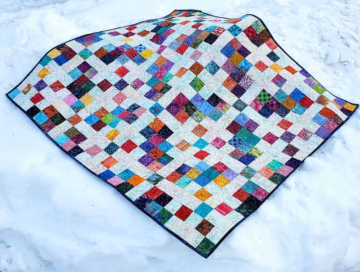 Scrappy Blocks quilt in the snow