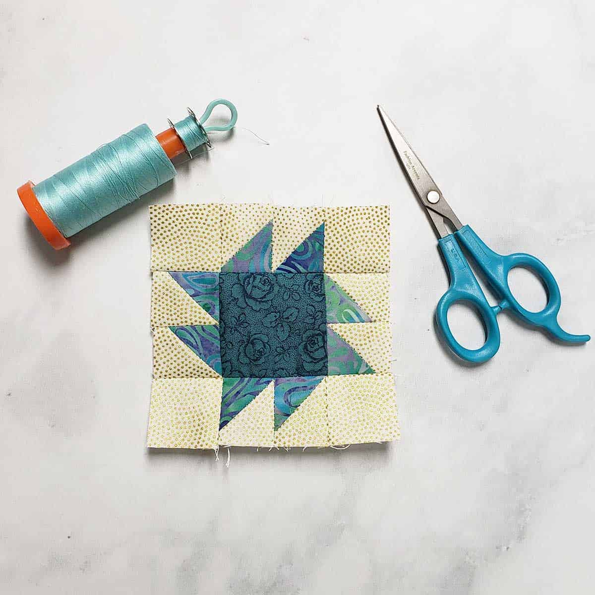 Square and Points quilt block with scissors
