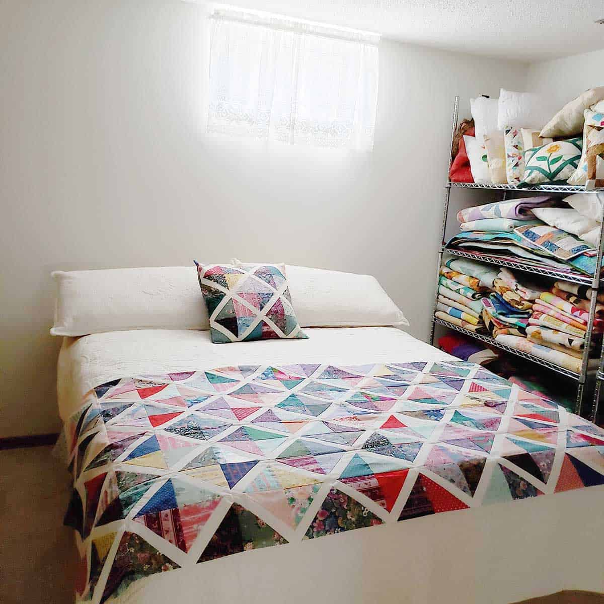 Guest bedroom with quilt and pillow
